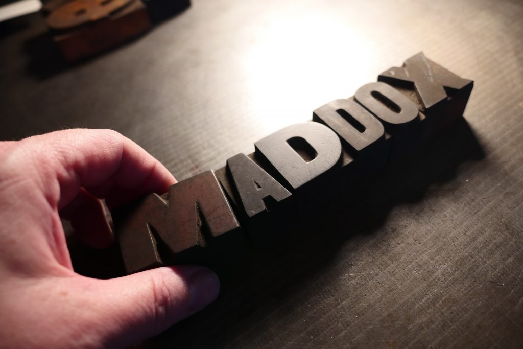 Setting 100 year old wood type to create the new Maddox logo