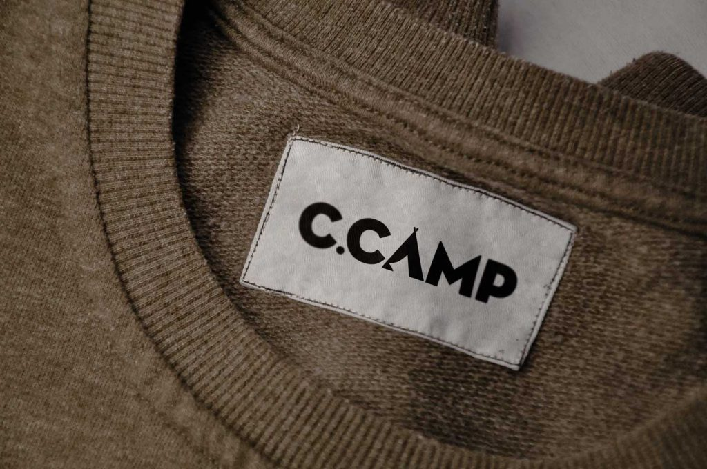 C.Camp logo on a sweater